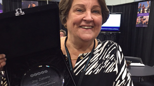 Photo of Joy Zabala holding her OCALI award